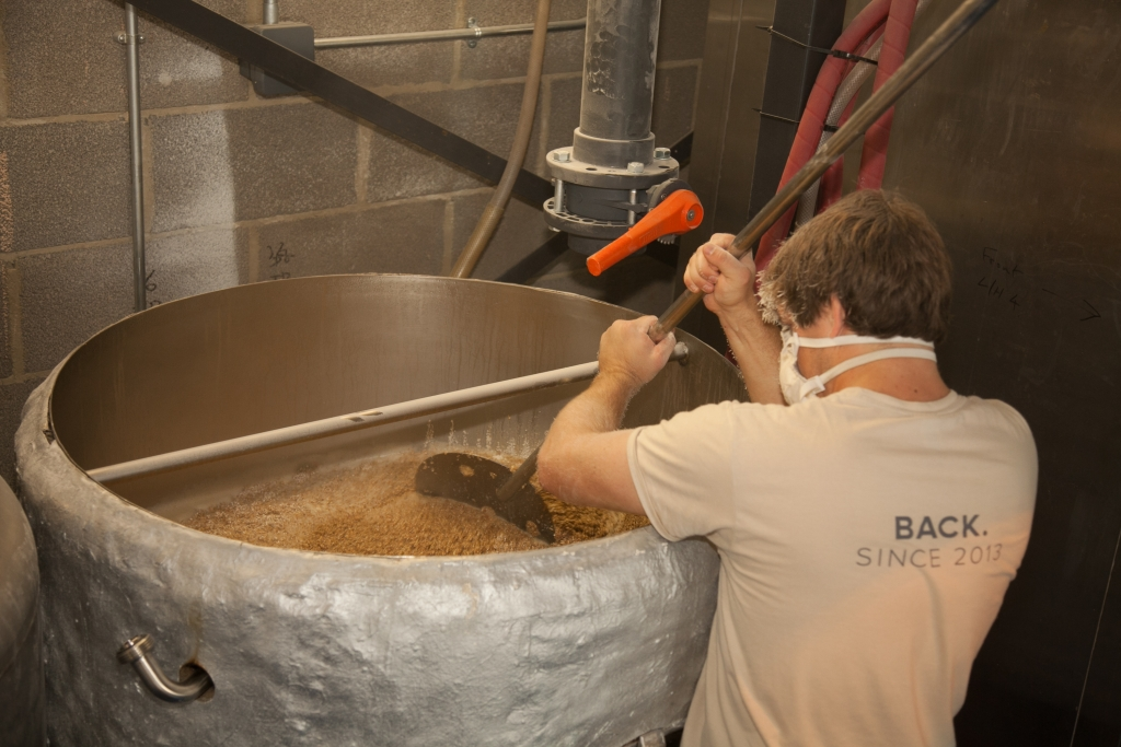 Head Brewer Mat mashing in a batch of Mane Event.